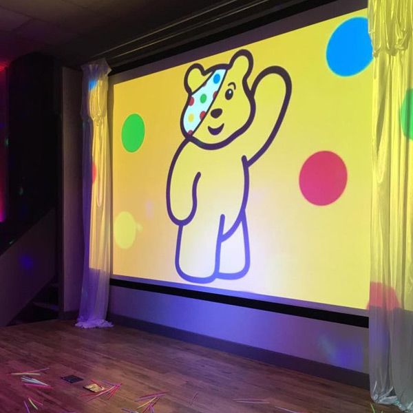 pudsey bear, projector screen, charity event