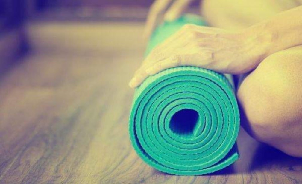 Blue yoga mat rolled up